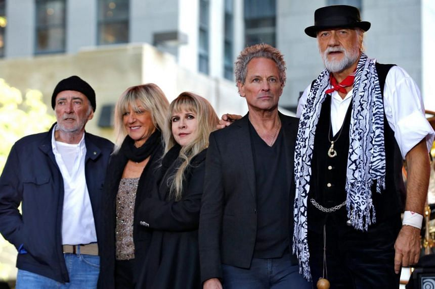 Fleetwood Mac said Lindsey Buckingham (second from right) will be replaced by two guitarists for their upcoming tour.