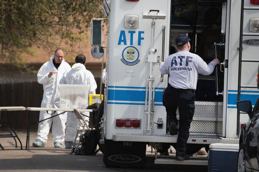 Law enforcement officials conducting an investigation at the home of suspected bomber Mark Conditt on March 22, 2018 in Pflugerville, Texas.