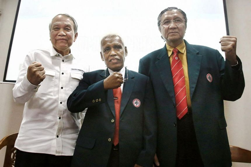 Indonesian Medical Association committee members Errol Hutagalung (left), Razak Thaha (centre) and Ilham Oetama Marsis attending a press briefing on the suspension of Major General Terawan Agus Putranto, who has been suspected of a medical-related et