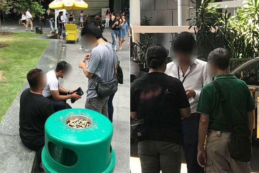 Plainclothes officers from the Singapore Customs in action at the central business district on April 6, 2018.