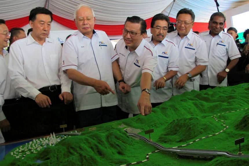 Malaysia's Prime Minister Najib Razak (third from left) and other officials looking at a model of the East Coast Rail Line on Aug 9, 2017.