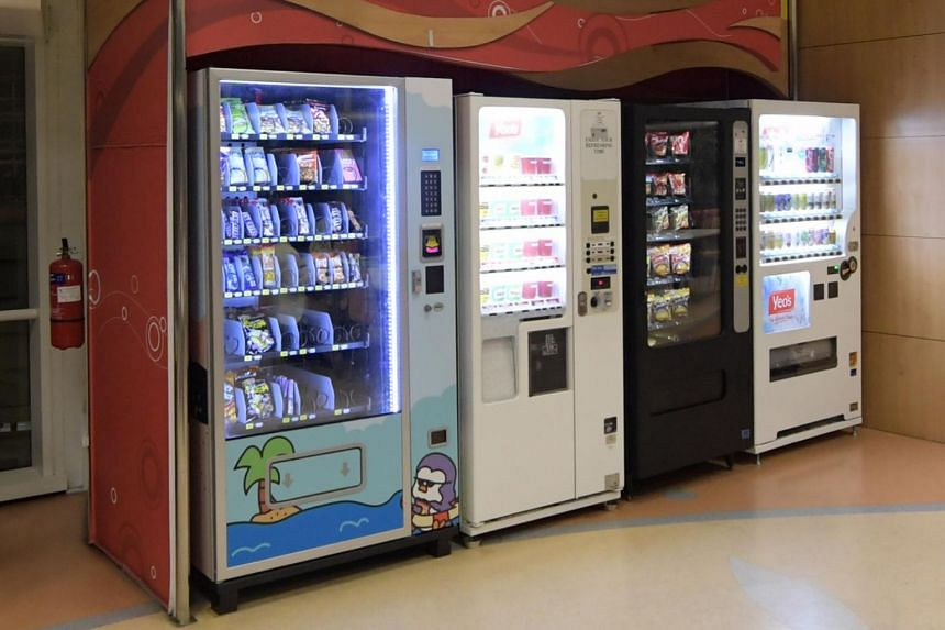 Vending machines with snacks and beverages pictured at the National Library along Victoria Street.