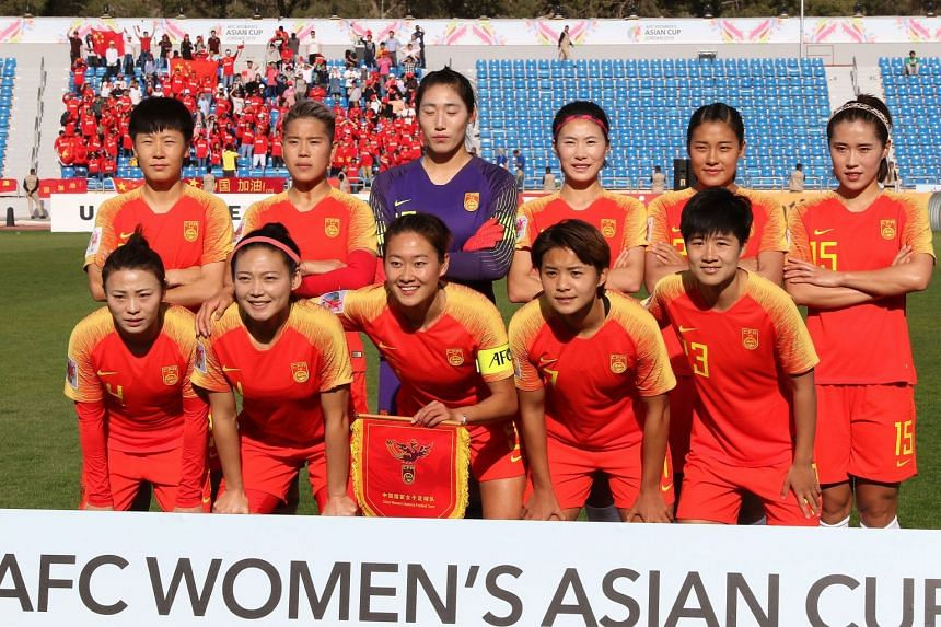 China's starting eleven pose for a group picture ahead of their match against Thailand during the AFC Women's Asian Cup in Amman on April 6, 2018.