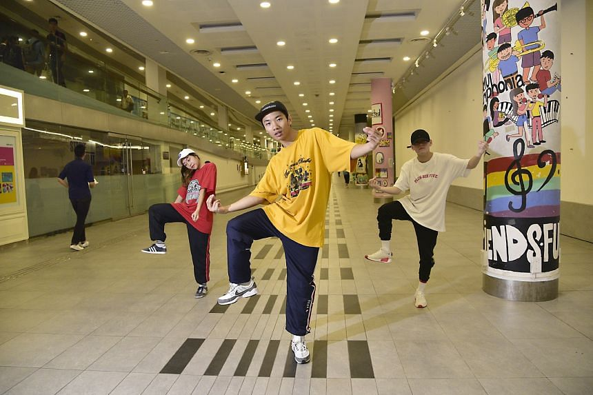 (From left) Dancers Andrea Muhammad, Tyron Cheah and Jason Kang at the Singapore Management University basement.