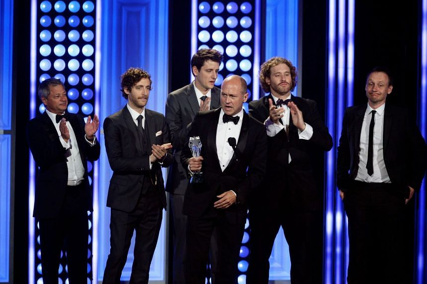 Silicon Valley producer Mike Judge (centre) and cast members, including Miller, accept an award for Best Comedy Series in 2015.
