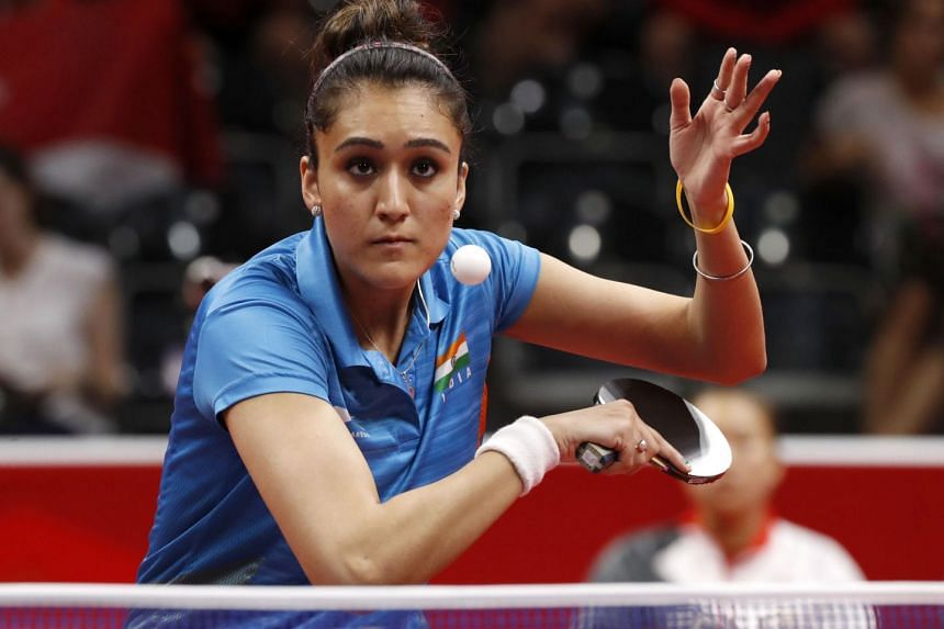 Manika Batra of India serving to Singapore's Feng Tianwei in the Gold Coast Commonwealth Games table tennis women's team final at the Oxenford Studios on April 8, 2018. Her shock win over the world No. 4 put India on the way to victory.
