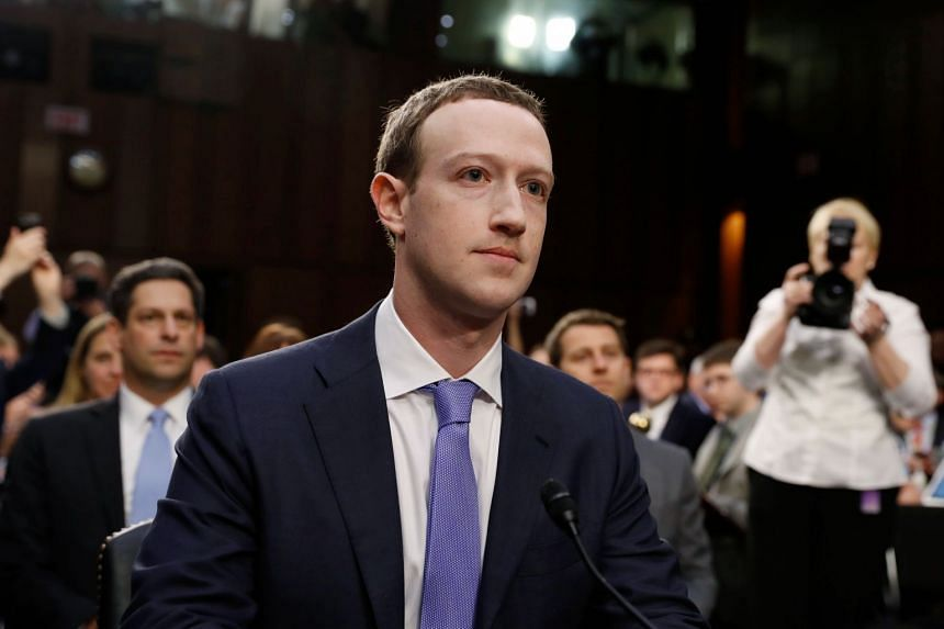 Zuckerberg listens to opening statements at the hearing.