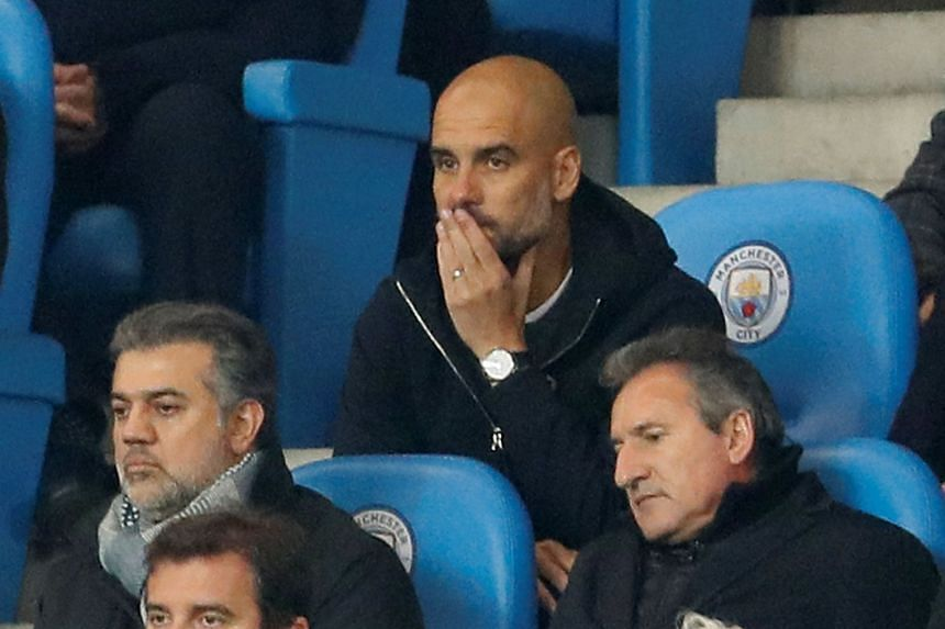 Guardiola sits in the stands during the second-half of the match.