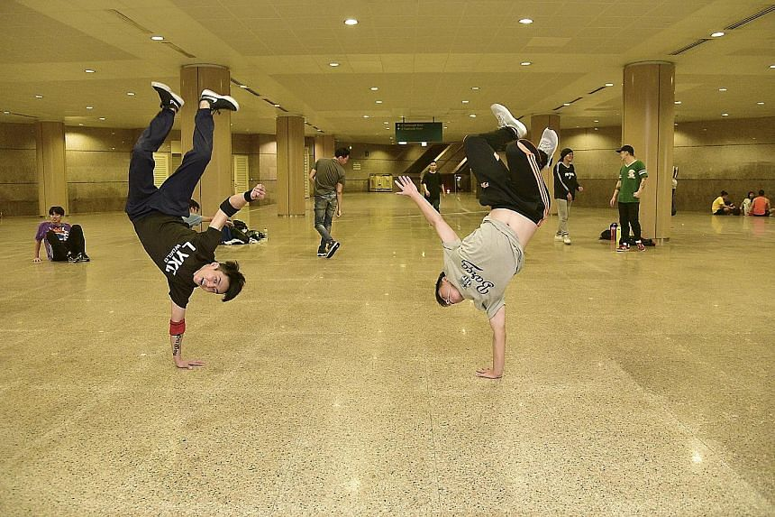Hip Hop dancers (from left) Andrea Muhammad, Tyron Cheah and Jason Kang at the SMU basement. One downside to using public spaces is having to make way for the university's students when they need the space, said Ms Andrea. Lighting technician Ong Yon