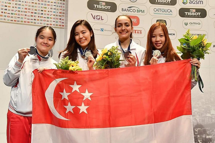 Above: The team comprising (from left) Maxine Wong, Nicole Wong, Amita Berthier and reserve Tatiana Wong upset higher-ranked Poland, France and Germany before falling to the United States in the final. Below: Amita Berthier got the better of Sylvie B