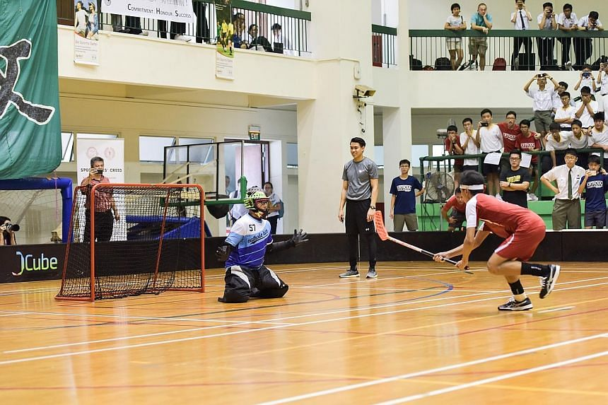 From top: Bukit Merah Secondary players celebrating Shin Thant's equalising goal in the last minute of normal time. John Alicante Embile's penalty whizzing past the Catholic High goalkeeper to give Bukit Merah their first B Division boys' floorball t