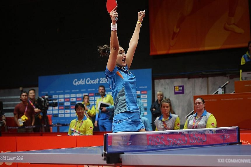 Manika Batra of India celebrating after winning gold against Singapore in the Commonwealth Games women's team event final last Sunday. Her win over world No. 4 Feng Tianwei in the first match set the tone for the 3-1 win.