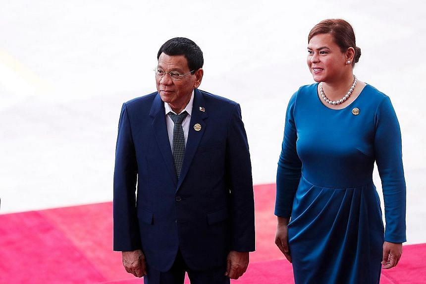 """Philippine President Rodrigo Duterte and his partner Honeylet Avancena arriving for the opening of the Boao Forum for Asia on China's Hainan Island yesterday. Mr Duterte said his country and China """"stand together in the war on criminality and the ill"""