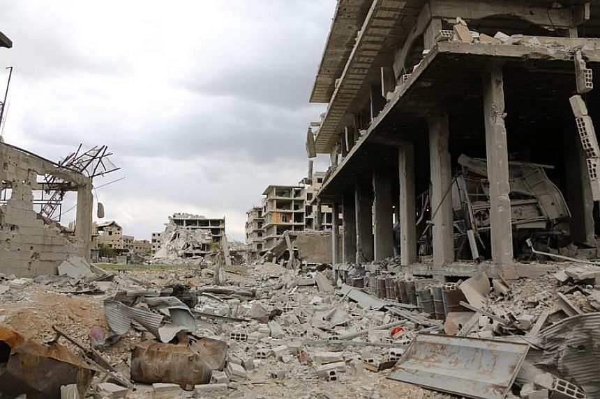 Destruction in the former rebel-held town of Saqba in the Eastern Ghouta region on the outskirts of the Syrian capital Damascus on April 10, 2018.