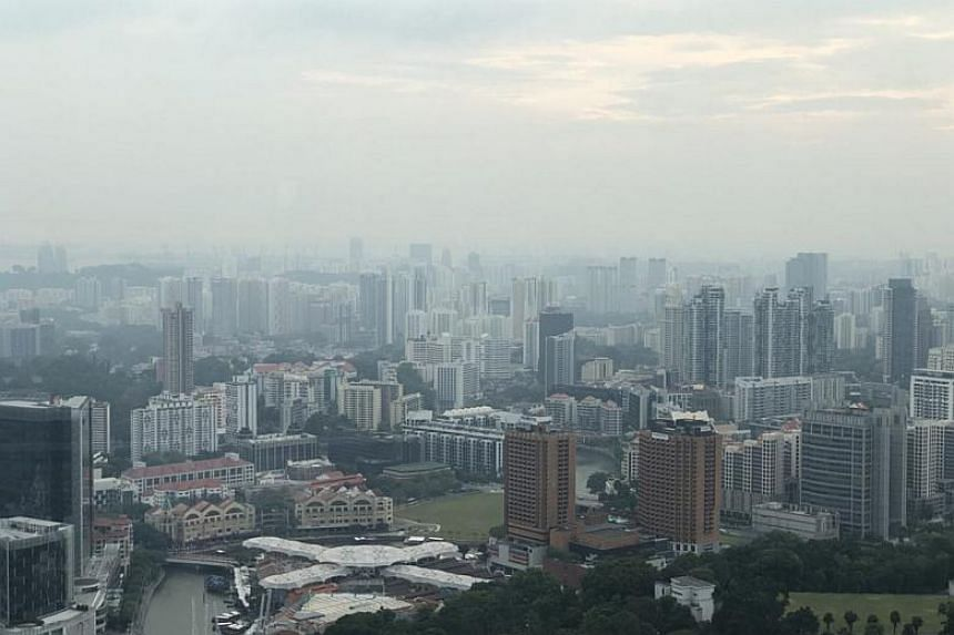 """View from the 70th floor of Swissotel the Stamford Singapore on April 11, 2018. The National Environment Agency said it detected """"a hot spot with dense smoke plume in the south-eastern part of Johor this afternoon""""."""