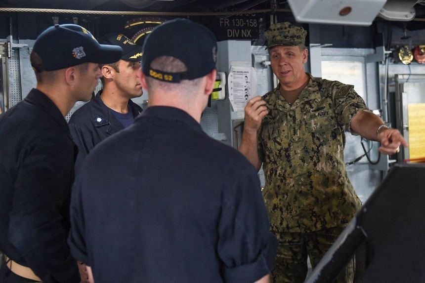 US Admiral Phil Davidson (right) speaking to officers on board the Arleigh Burke-class destroyer USS Barry in Yokosuka, Japan, on Oct 17, 2017.