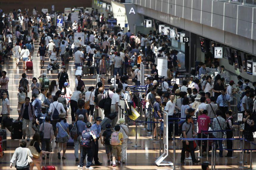 The departure lobby at Haneda Airport in Tokyo, Japan.