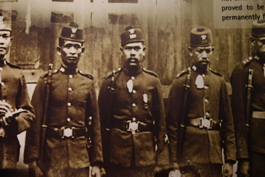 Old uniform worn by police officers in Singapore in the past.