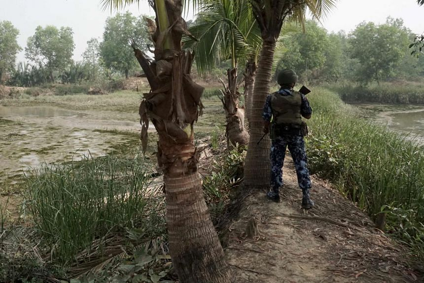 An armed Myanmar border guard in Rakhine state in March 2018 at the border with Bangladesh.