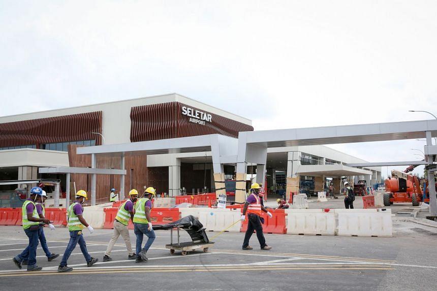 Construction workers at the new passenger facility at Seletar Airport.
