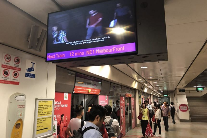 A sign showing at Serangoon MRT station showing that the train will take about 12mins to arrive.
