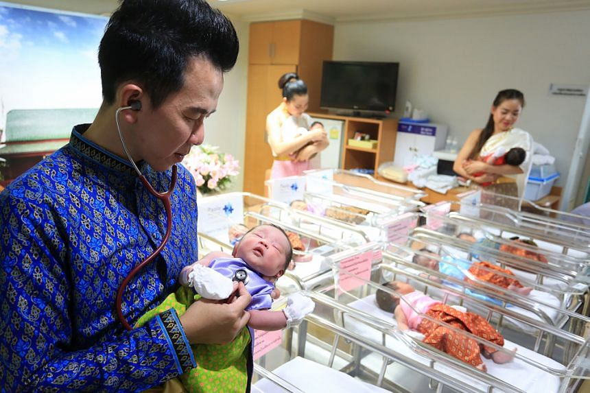 Medical staff at Paolo Memorial Hospital Chokchai 4 in Bangkok wore period attire and dressed newborn babies in Thai traditional outfits ahead of the Songkran Festival.