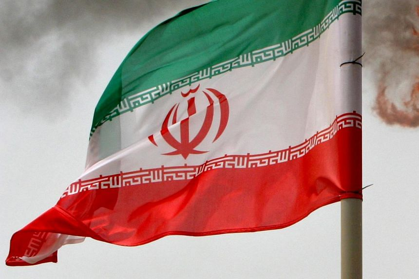 File photo showing the Iranian flag on an oil production platform in the Persian Gulf.