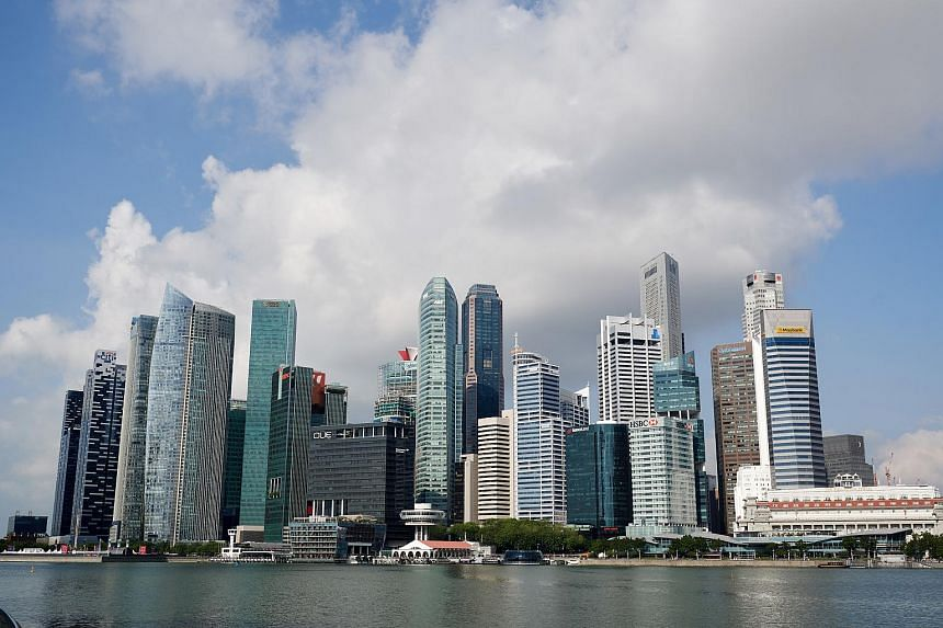 Skyscrapers in Singapore's central business district seen from the Marina Bay Sands promenade.