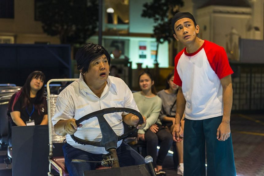 Actors Johnny Ng (left) and Yazid Jalil acting as a bus driver and a teenager respectively in the theatre production Four Horse Road.