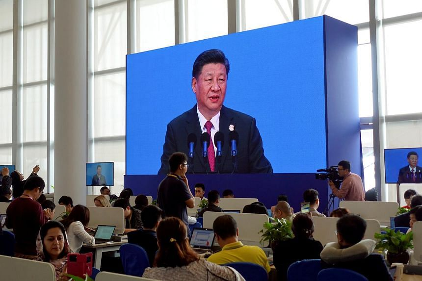 Reporters at media centre of Boao Forum for Asia watch Chinese President Xi Jinping delivering his speech at the annual forum, in Boao, in the southern Chinese province of Hainan, China on April 10, 2018.