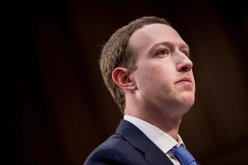 Facebook CEO Mark Zuckerberg listens during the hearing.