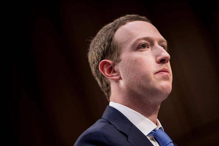 Facebook CEO Mark Zuckerberg listens during the hearing.