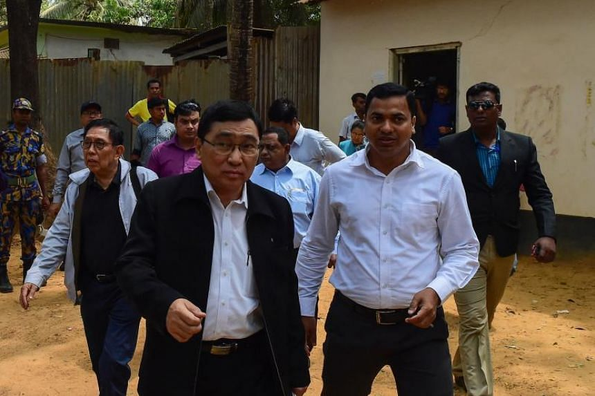 Myanmar Social Welfare Minister Win Myat Aye (left) arrives at Kutupalong refugee camp in Bangladesh's Ukhia district on April 11, 2018.