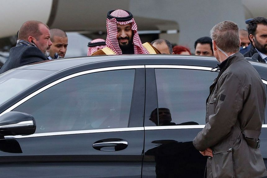 Crown Prince Mohammed bin Salman makes his way to his car upon arriving in Spain.
