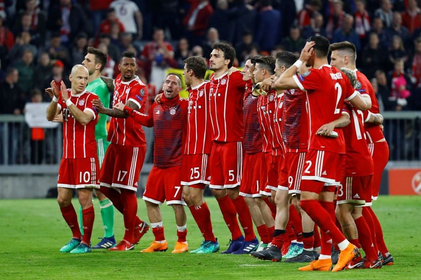 Bayern Munich players celebrate at the end of the match.