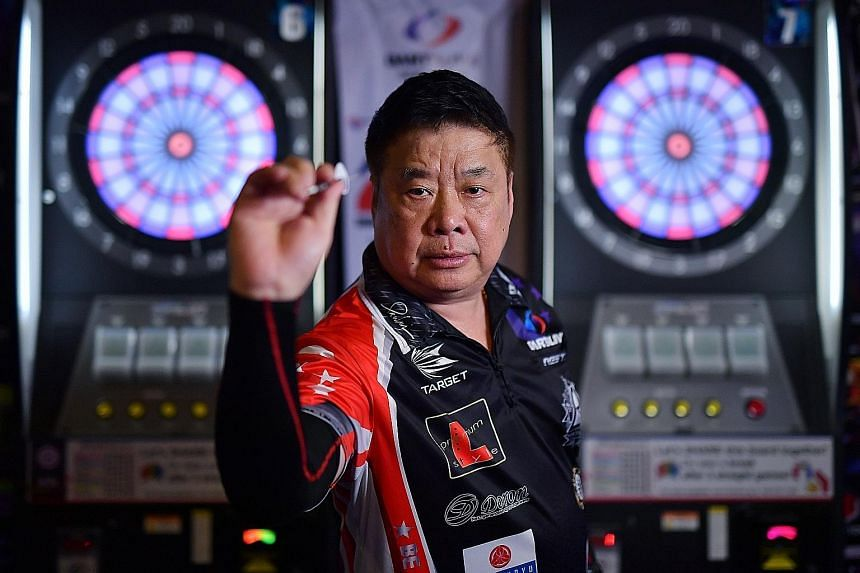 Hong Kong-based Singaporean Paul Lim practising at iDarts Fame 2 at Safra Jurong. He has grabbed global headlines twice - first in 1990, when he became the first person to throw a perfect nine-dart finish at the World Championship, and again last yea