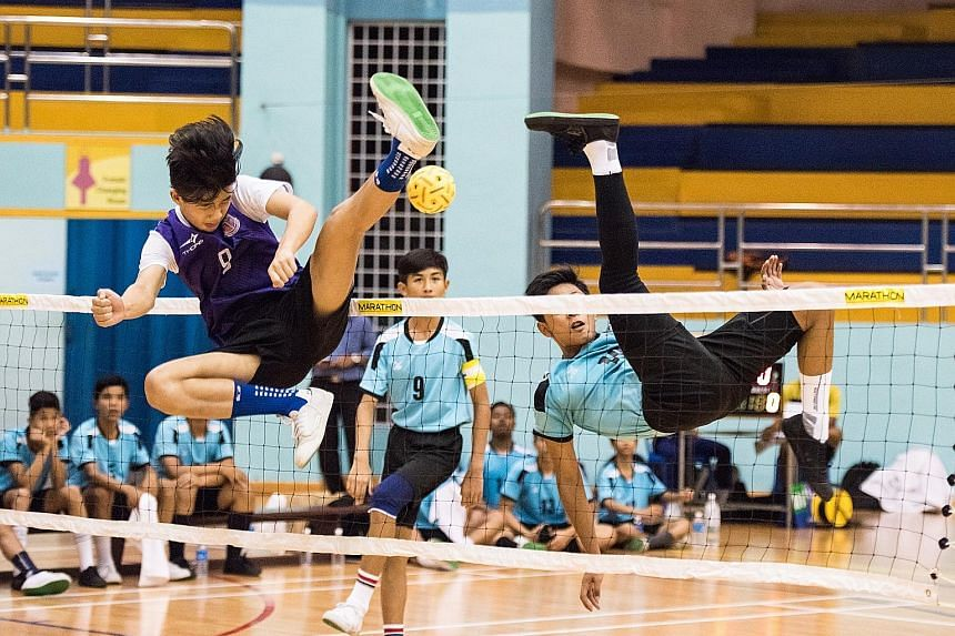 Queensway Secondary School (in purple) were crowned Schools B Division sepak takraw champions yesterday after beating Assumption Pathway School 2-1 at the Yio Chu Kang Sports Hall. It was their third straight B Division boys' title. Queensway also ce