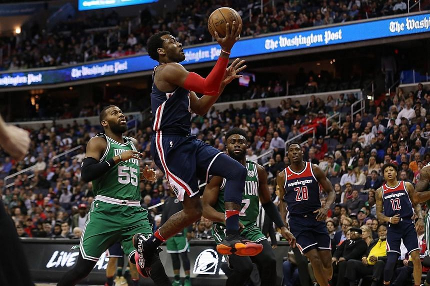 Wizards guard John Wall shooting the ball at the Capital One Arena in Washington during their 113-101 win over the Boston Celtics. Both teams could face each other again in the play-offs, should the Wizards finish seventh in the Eastern Conference.