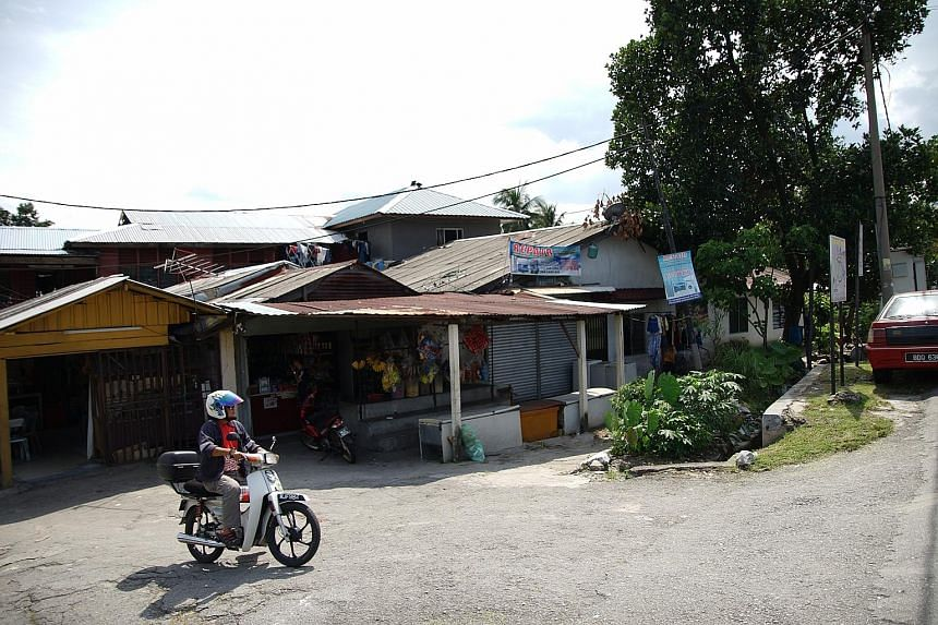 These three tiny shops in Kuala Lumpur's Wangsa Maju constituency share one address, with 17 voters registered as residents there. A cashier at one of the stores said no one lives on the premises.