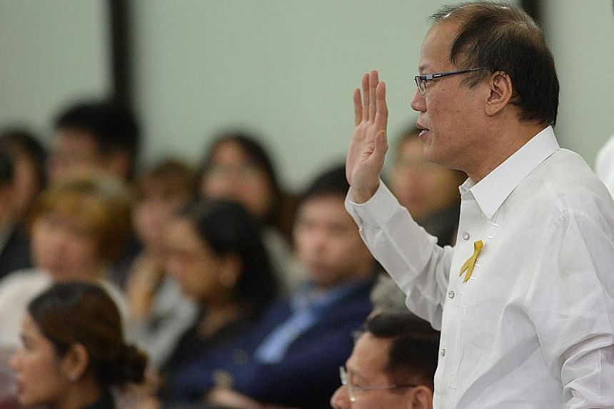 Former president Benigno Aquino testifying during the vaccine controversy congressional hearing in Manila in February.
