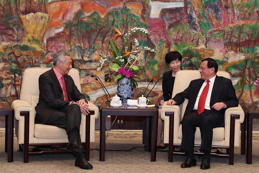 Shanghai's new party secretary Li Qiang (right) outlined four areas in which he hoped to see greater cooperation with Singapore during his meeting with Prime Minister Lee Hsien Loong.