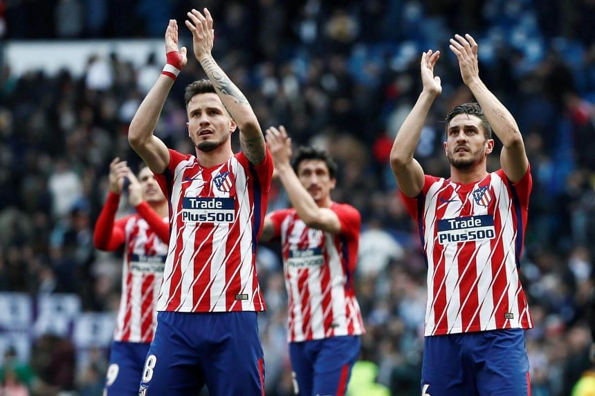 Atletico Madrid's players clap for their fans after the derby with Real Madrid at the Santiago Bernabeu stadium on April 8, 2018