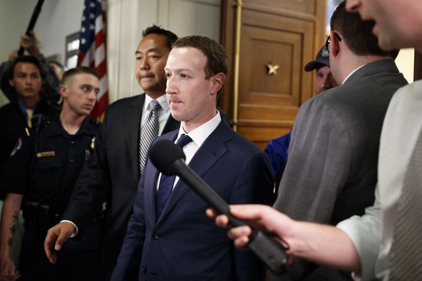 Mark Zuckerberg exits after testifying on Capitol Hill in Washington, April 11, 2018.