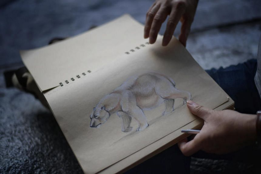 Lecturer Philip Garcia, who has been drawing animals at the Singapore Zoo for the past seven years, also turned up to sketch Inuka.
