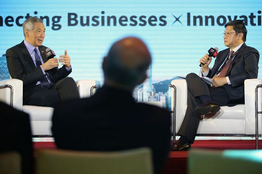 Prime Minister Lee Hsien Loong speaking at a dialogue at the DBS Asian Insights Conference in Shanghai on April 12, 2018, moderated by Mr Robin Hu, head of Temasek's sustainability and stewardship group.