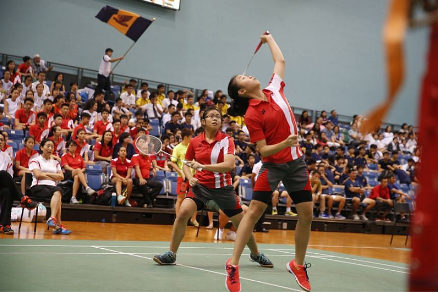 Singapore Sports School's Joey Koh Yu Han (left) and Rennie Yow Jia Yi (right) in action during the National B Division badminton doubles final on April 12, 2018.