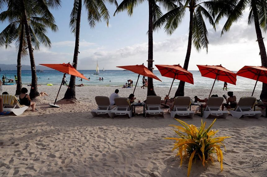 Tourists resting on the beach at Boracay, Philippines on April 8, 2018.