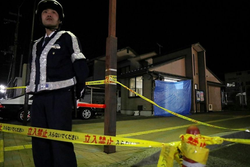 A policeman stands guard outside a sealed off police office on April 12, 2018, where an officer was shot dead on April 11, in western Japan's Hikone, Shiga prefecture.