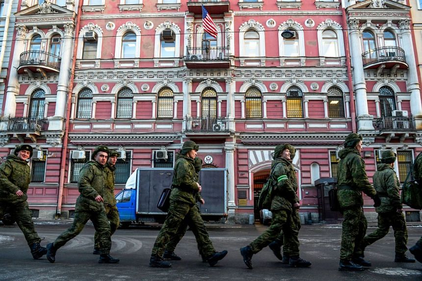 Russian soldiers march past the US Consulate in Saint Petersburg on March 31, 2018.