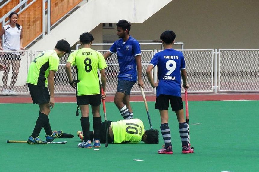Northland's Muhammad Raihan Adris on the ground with an ankle injury during the match. Northland won 4-3, taking the bronze.